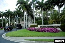 The motorcade of U.S. President Donald Trump arrives at Trump International Golf Club in West Palm Beach, Florida, April 15, 2017.