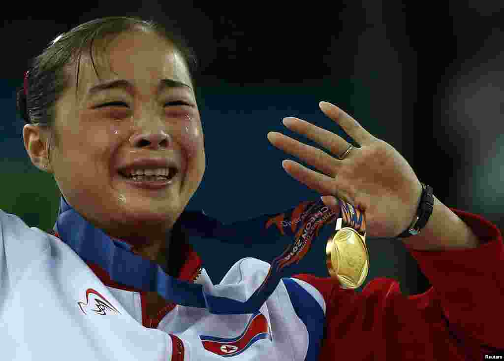 North Korea's gold medalist Kim Un Hyang cries during the medal ceremony for the women's beam final of the artistic gymnastics competition at the Namdong Gymnasium Club during the 17th Asian Games in Incheon, South Korea.