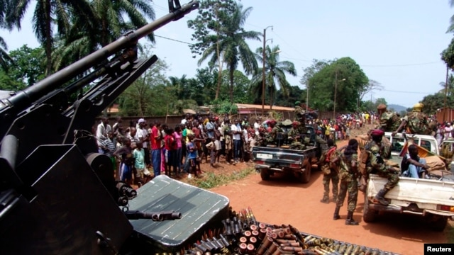 Armed fighters from the Seleka rebel alliance patrol the streets in pickup trucks to stop looting in Bangui, March 2013.