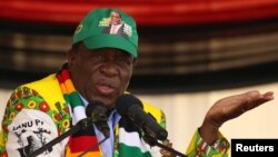 FILE: President Emmerson Mnangagwa addresses an election rally of his ruling ZANU-PF party in Mutare, Zimbabwe, May 19, 2018.