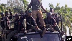 Nigerian troops seen on patrol.