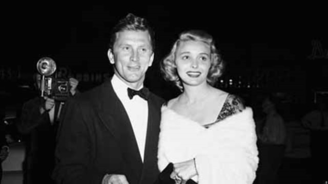 """Patricia Neal is escorted by Kirk Douglas to the world premiere of the movie """"The Fountainhead"""" in Los Angeles in 1949"""