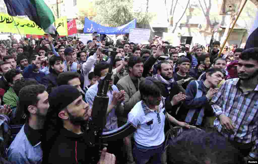 Protests against Syria's President Bashar al-Assad take place in Aleppo, March 29, 2013.