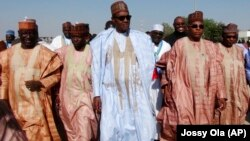FILE - Nigerian presidential candidate Muhammadu Buhari, center, from the All Progressives Congress (APC) party arrives for a party rally in Maiduguri, Nigeria, Feb. 16, 2015.