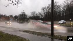 Imágen de las indundaciones tras una tormenta en Kalamazoo, Michigan, el martes, 20 de febrero de 2018. (Meagan Beck/Kalamazoo Gazette-MLive Media Group via AP)