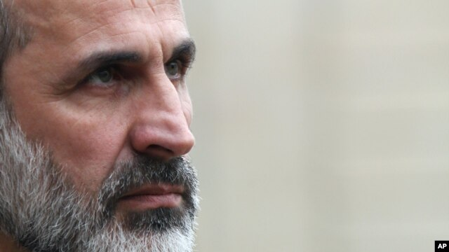 Lãnh tụ đối lập Syria đang sống lưu vong Mouaz al-Khatib.