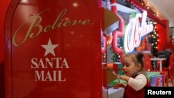 REUTERS Child sending a letter to Santa Clause