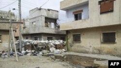 Ðường phố ở Homs bị bom đạn tàn phá
