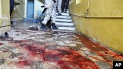 Stains of blood cover a hallway inside the Hotel Muna in Mogadishu, 24 Aug 2010
