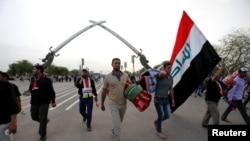Para pengikut ulama Syiah Irak, Moqtada al-Sadr, meninggalkan Zona Hijau di Baghdad, Irak, 1 May 2016 (Foto: dok).