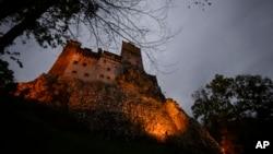 Bran Castle lies on top of cliffs in Bran, Romania, Oct. 9, 2016.