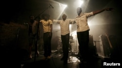 Malian band Songhoy Blues members, Nathanael Dembele (L-R), Garba Toure, Aliou Toure and Oumar Toure, react at the end of their concert at Village Underground in London, May 28, 2015.
