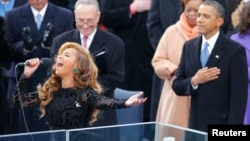 Beyonce sings the National Anthem as President Barack Obama (R) and Senator Charles Schumer (D-NY) listen during swearing-in ceremonies on the West front of the U.S. Capitol, Jan. 21, 2013.