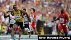 Usain Bolt (à g.) et Justin Gatlin (à dr.) (Reuters)