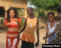 Teacher and Starling Sponsorship Program founder Ashleigh DeLuca (left) with students in 2008. (Courtesy photo)