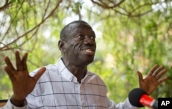 FILE - Opposition leader and presidential candidate Kizza Besigye speaks to the media while under continued house arrest, at his home in Kasangati, outside the capital Kampala, in Uganda, Feb. 21, 2016.