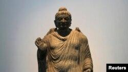 د بودا یوه مجسمه چې په ٢٠١٢ بریتانیا بیرته افغانستان ته ورکړې ده