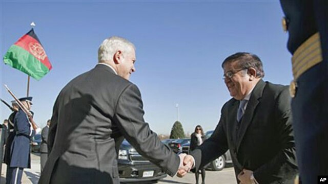 Defense Secretary Robert Gates greets Afghanistan Defense Minister of National Defense Abdul Rahim Wardak at the Pentagon, February 23, 2011
