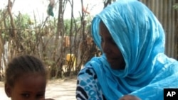 Five year old Hasna with her mother Nehina Mohammed luckily spared from undergoing FGM. Amibara District, Affar (2010)