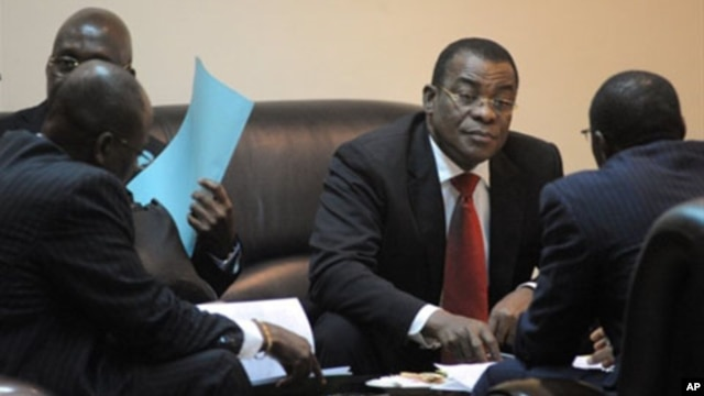 The representative of Ivorian incumbent President Laurent Gbagbo, Pascal N'guessan (C), speaks with members of his delegation on March 10, 2011 before the start of African Union talks in Addis Ababa