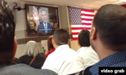 """The new U.S. citizens received a personal greeting from U.S. President Barack Obama, on a plasma screen TV. """"You can help write the next great chapter in our American story,"""" Obama said. """"I'm proud to welcome you as a new citizen of this country."""""""