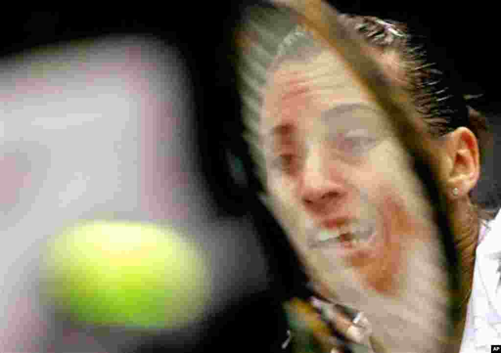 Flavia Pennetta of Italy, returns the ball to Elena Vesnina of Russia during the Kremlin Cup tennis tournament in Moscow, Russia, Tuesday, Oct. 19, 2010. (AP Photo/Misha Japaridze)