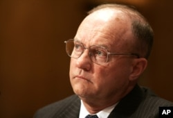 FILE - Lawrence Wilkerson, former chief of staff to Secretary of State Colin Powell, testifies on Capitol Hill, June 26, 2006.