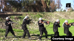 "Chilren are seen carrying weapons and performing military drills in this still from an IS video called ""Blood of Jihad 2."""