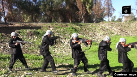 Chilren are seen carrying weapons and performing military drills in this still from an IS video called 'Blood of Jihad 2.'