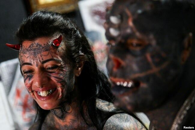 'Devil Prado' tattooed on 80% of body part
