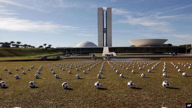 Soccer balls representing Brazilian lawmakers sit in rows in front of Congress as a protest against spending on the Confederations Cup soccer tournament in Brasilia, June 26, 2013.