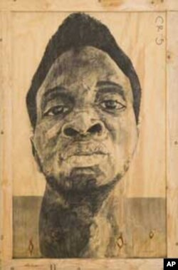 A self-portrait of Serge Alain Nitegeka, in charcoal