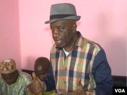 El Hadj Oumarou, Cameroon coordinator of the land freight transportation bureau, offers encouragement to stranded drivers in Garoua Boulay, March 19, 2019. (M.E. Kindzeka/VOA)