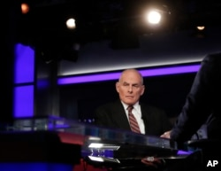 White House chief of staff John Kelly pauses to look to a video monitor as he appears with Bret Baier on Fox News in Washington, Jan. 17, 2018. Kelly said President Donald Trump's views on many issues had evolved since the 2016 campaign.