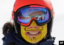 An Italian skier has her face covered in tape to protect her from the cold during an inspection of the giant slalom course at the Yongpyong Alpine Center at the 2018 Winter Olympics in Pyeongchang, South Korea, Feb. 11, 2018.