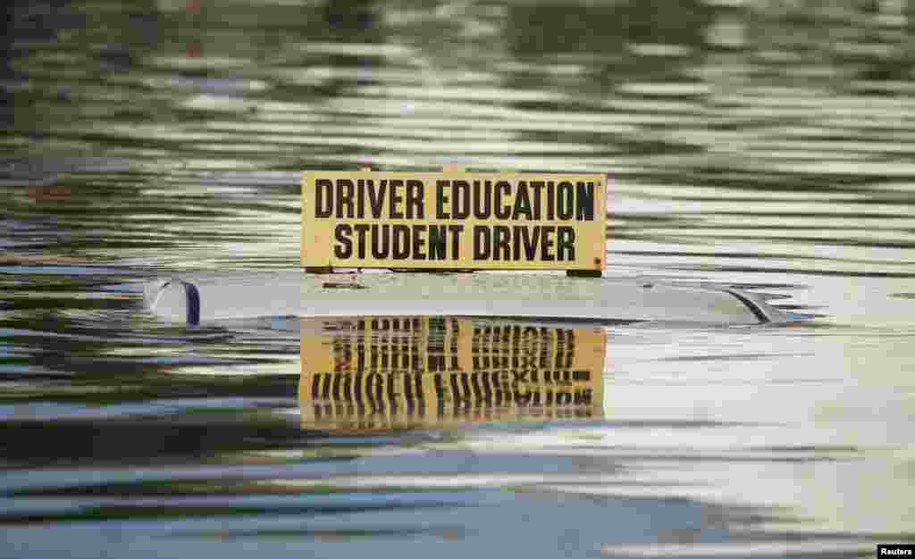 A driver education vehicle is seen submerged in floodwaters following Hurricane Matthew in Lumberton, North Carolina, Oct.10, 2016.