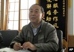 丹東市外經貿局官員黃憲民