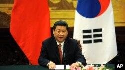 시진핑 중국 국가주석이 지난해 6월 박근혜 한국 대통령의 중국 국빈 방문 당시 베이징 인민대회당에서 공동성명을 발표하고 있다. (자료사진)