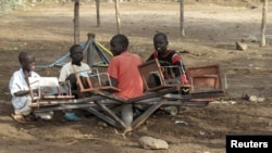 Sudanese children play with a broken playground chair in Kakuma refugee camp in Kenya. (File Photo)
