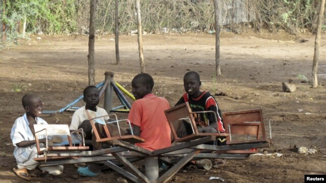 Sudanese children play with a broken playground chair in Kakuma Refugee camp, which houses over 60,000 refugees in North western Kenya. (File Photo)