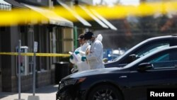 Police forensic investigators collect evidence at Bombay Bhel restaurant, where two unidentified men set off a bomb late Thursday night, wounding 15 people, in Mississauga, Ontario, Canada, May 25, 2018.