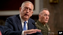 Defense Secretary Jim Mattis, left, accompanied by Joint Chiefs Chairman Gen. Joseph Dunford, speaks before the Senate Armed Services Committee on Capitol Hill in Washington, Oct. 3, 2017.