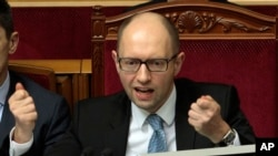 FILE - Ukrainian Prime Minister Arseniy Yatsenyuk speaks to lawmakers during a session at the Ukrainian parliament in Kiev, Ukraine, April 18, 2014.