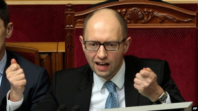 FILE - Ukrainian Prime Minister Arseniy Yatsenyuk is seen speaking to lawmakers in Kyiv, Ukraine.
