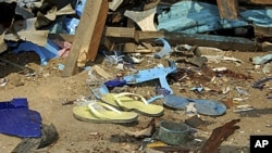 Shattered remnants are seen at the site of a bomb blast at a bar in the Nigerian northeastern city of Maiduguri