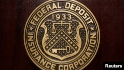 The Federal Deposit Insurance Corp (FDIC) logo is seen at the FDIC headquarters.