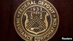 FILE - The Federal Deposit Insurance Corp (FDIC) logo is seen at the FDIC headquarters.