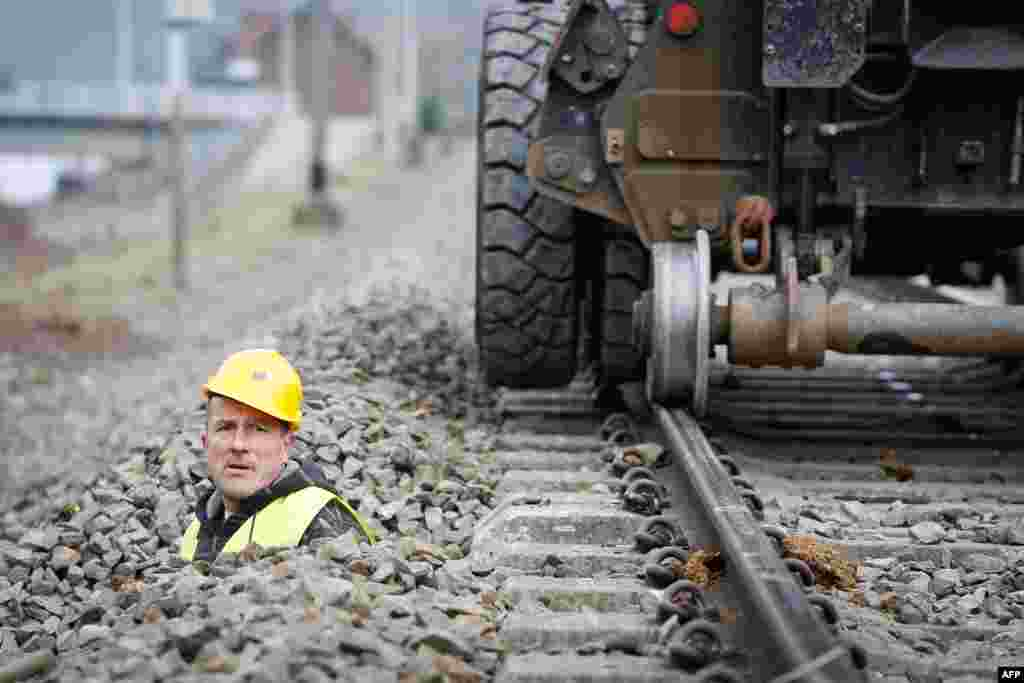 A worker checks what will be the first ETCS (European Train Control System) line in Profondeville, Wallonia, Belgium. The modernization of the line, between Jambes and Dinant, will enable the system to automatically stop a train that neglects a red light or exceeds the maximum speed limit.