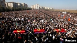 Thousands attend the funeral ceremony of the three Kurdish activists shot in Paris, in Diyarbakir, Turkey, January 17, 2013.