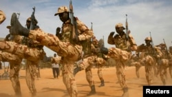 FILE - Chadian soldiers march a training mission for African militaries, in Diffa, Niger, March 3, 2014. A multi-national military force in Africa's Sahel region launched its campaign Oct. 28.